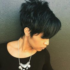spiky black haircut with bangs
