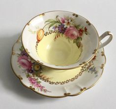Vintage E.B Foley china tea cup and saucer, made in England. An absolutely stunning set, pale yellow and white with lovely flowers. It is in good condition, no chips, cracks, crazing or repairs. Please Note: The items I sell are not new, they are vintage or antiques, it goes
