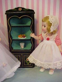 Vintage black lacquered Pennsylvania Dutch corner cabinet.  Similar piece shown in Doll Furniture by Jean Mahan, page 96.