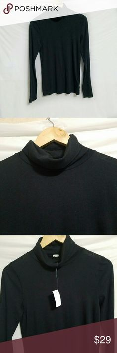 Retail J. Crew turtleneck Black lightweight turtleneck from J. Crew. Long-sleeved. Soft cotton. Armpit. To armpit measures about 16 inches for a loose fit. Length is about 26 inches from the seam at the top of the shoulder, under the collar. Basic essential for any closet. J. Crew Tops