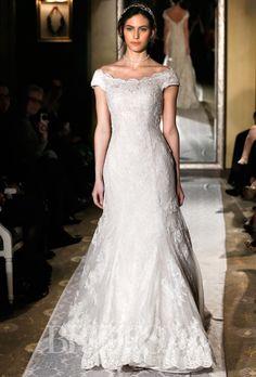 Brides.com: The New Classic: 26 Off-the-Shoulder Wedding Dresses . Wedding dress by Oleg Cassini