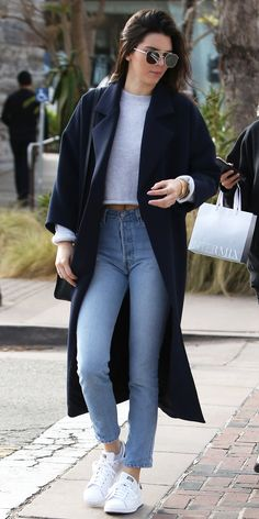 Don't dismiss the mom jean just yet—Jenner gave the straight-leg high-waist style a cool-girl spin by playing with proportions, pairing the denim with a crop top and long coat.