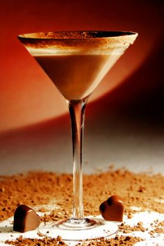 Milky Way Martini:  2 ozs. rich dark chocolate vodka; 1/2 oz. vanilla vodka; 1 oz. butterscotch schnapps.  Combine in shaker w/ice  pour in martini glass.