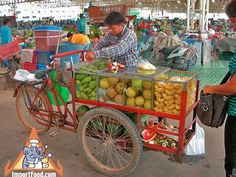Thai Street Vendor Offers Fresh Fruit from a Bicycle Cart