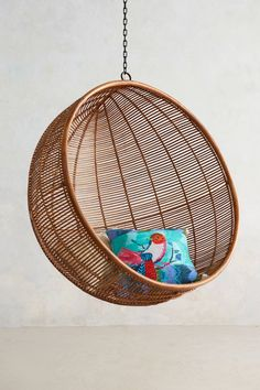 can't get enough hanging chairs these days... Rattan Hanging Chair - anthropologie.com