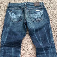 Armani Exchange wing pocket jeans Gorgeous jeans worn a couple times. Authentic, great condition. Blue wing pockets. Size 2 short. Fits 26 Armani Exchange Jeans Flare & Wide Leg