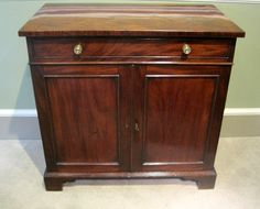 A fine George III period mahogany two door side cabinet, with a dummy drawer and fitted side drawer, period brass handles and original bracket feet. Circa 1780.