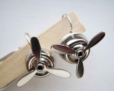 I bought them! They spin! I love the girliness of earrings meeting the mechanics of a propeller. Industrial chic.