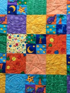Free motion quilting on dinosaur baby quilt from http://www.HomeSewnByCarolyn.com
