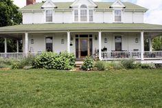 Farm house~ This is my dream house. Big farm house with wrap around porch. Let me at that yard with some bright colored flowers!