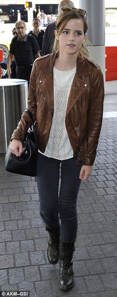 Emma Watson dresses down in a vintage leather jacket and biker boots as she catches a flight out of Los Angeles.