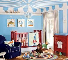 Cool circus themed room - love the artwork on the walls.....love the RED crib!
