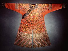 Chinese dress in the Qing dynasty. Scroll down to see a glossary of auspicious symbols.