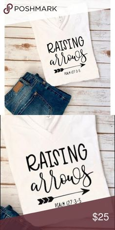Raising arrows tshirt Raising arrows tshirt. It features a super soft white tee with the phrase written above Made of 50% Cotton and 50% Polyester. It is 100% handmade with adhesive vinyl ensuring for a long lasting wear. Sizing notes:  X-Small - 0/2  Small - 4/6  Medium - 8/10  Large - 10/12  X-Large - 14  2X-Large - 16 Tops Tees - Short Sleeve