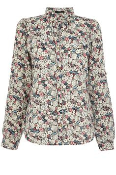 This lightweight cotton shirt is the perfect easy breezy addition to your spring wardrobe. The piece features a pretty ditsy floral print across the fabric and has a open v neckline, The piece is finished with concealed button fastenings on the lapel. High Street Shops, Flower Shirt, Floral Tops, Ditsy Floral, Going Out, Tunic Tops, Shirt Dress, Oasis, My Style