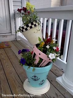 How cute, secure pots with post or bard steel up through the pots then slant and fill with soil