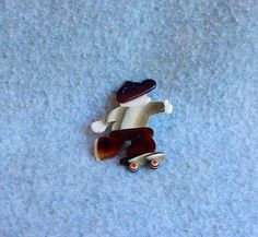 Lea Stein Skateboard Boy Brooch 70's Pin Brown Cap Pants Tan Cream Signed Vintage Figural Celluloid Costume Jewelry French Designer Paris by Kissisjustakiss on Etsy