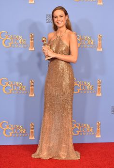 Making a glittering statement on the red carpet in Calvin Klein Collection, Brie Larson won for Best Actress in a Drama Motion Picture for Room.