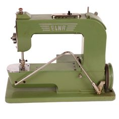 Elna Swiss Sewing Machine (I have an Elna! Same color...60 Years old, I'm guessing...it was my mom's. sjm)