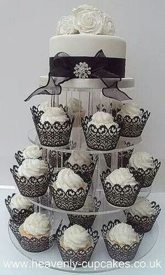The idea of one main cake with cupcakes, I'm stuck on. The containers that the cupcakes are in are beautiful.