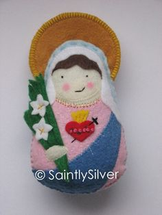 Immaculate Heart of Mary Felt Saint Softie by SaintlySilver, $20.00?  She has tons, and will make a custom one. LOVE!