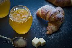 Puff-pastry croissants w homemade orange marmalade - Homebaked Puff-pastry croissants with homemade orange marmalade and butter. Rustic setting. Selective focus.
