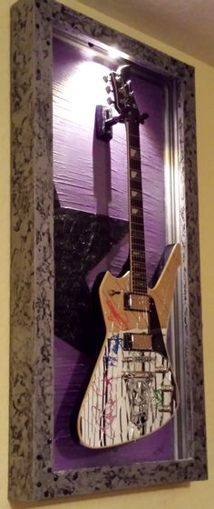 http://www.jelisdecor.com/kiss-guitar-display-case-stanley-deluxe-shadow-box-w-led-light/