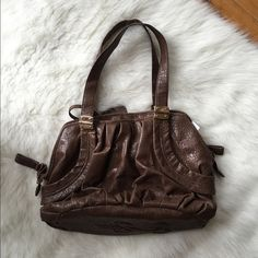 Jessica Simpson Brown Leather Handbag This is in perfect condition! No stains or flaws in it. 14 inches across the bottom 11.5 inches tall  NO TRADES PLEASE Jessica Simpson Bags