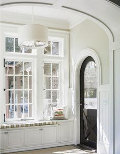 Lovely arched door. Love all the windows!!