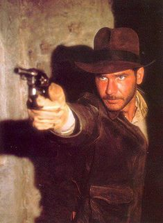 Harrison Ford as Indiana Jones shooting bad guys from Raiders Of The Lost Ark Henry Jones Jr, Harrison Ford Indiana Jones, Indiana Jones Films, Sci Fi Movies, Good Movies, Awesome Movies, People Of Interest, Steven Spielberg, Scene Photo