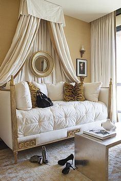 luxury daybed, classical French Empire styling. all white and tape. custom bedding with complimentary design service at DesignNashville.com shipping world wide.