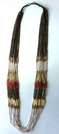 Rose colored Multistrand beaded necklace Gold tone Seed bead Jewelry. $55.00, via Etsy.