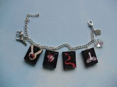 Twilight book charm bracelet made from polymer clay and finished off with a satin glaze. Available on my Etsy shop [link] Twilight book charm bracelet Twilight Wolf, Twilight Quotes, Twilight Saga Series, Twilight Pictures, Twilight Movie, Twilight Outfits, Book Necklace, Clay Charms, Bracelet Making