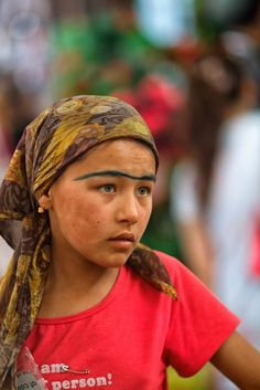 Uyghur girl at market in Kashgar.