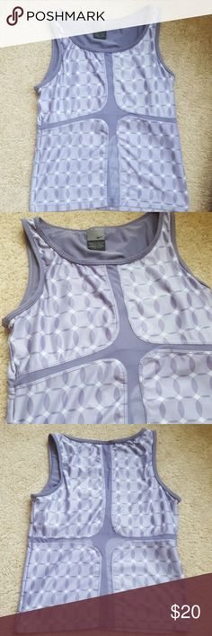 Beautiful Nike Workout Top Light purple fitted Nike top with built in bra. Polyester and spandex material with mesh cutouts. Very cute. Never worn. Comes from a smoke-free pet-free home. Fast shipping. NO TRADES! Nike Tops