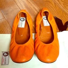 100% Authentic Lanvin Orange Flats These have been well loved but are in good condition. They are adorable spring/summer shoes and fit true to size. I did not keep the box but do have the original Lanvin bag. Lanvin Shoes Flats & Loafers