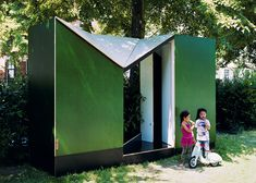 """Easehouse Temporary Restroom - Lagado Architects - ...wide open sections in the roof so users can sit on the toilet and look up into the sky. """"The open roof reinforces the idea of still being outside while providing the necessary ventilation... The trees above the roof give a protected and covered feeling"""" ...the building is split into two toilets, one for adults and one for children, neatly divided by a central entrance and a diagonal step."""