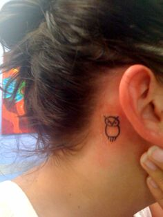 Small Owl Tattoo On Girl Right Behind The Ear