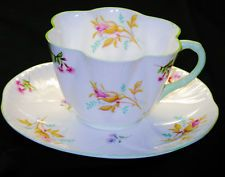 SHELLEY DAINTY UNIVERSAL ROSE BUD  TEA CUP AND SAUCER