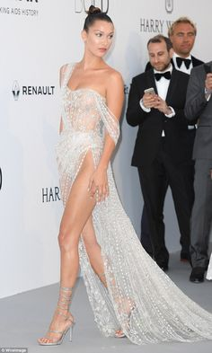 Taking on the carpet... Bella Hadid attended an amFAR event in Cannes on Thursday night...