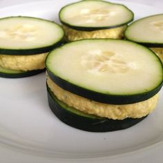 cucumber + hummus sandwiches.  Finally something to use my hummus and cucumbers for. Duh. Why don't I think of simple things like this?