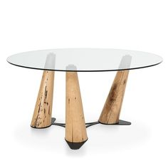 Laguna fixed dining table by Sedit, with a round or rectangular table top in a white clear tempered glass, In addition, the legs are obtained from french oa.