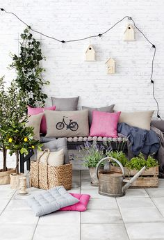 hanging bird houses and colorful pillows for your patio
