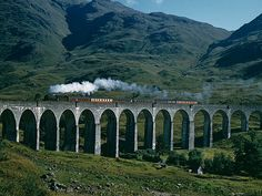 11 Real-Life Harry Potter Destinations You Can Visit | THE JACOBITE, SCOTLAND | Looking for an attraction that will scratch your Harry Potter sight-seeing itch and satisfy your travel companions? Try the Jacobite, a steam train that runs along the western coast of Scotland, giving travelers a gorgeous view of the Scottish countryside – and make you feel like you're riding the Hogwarts Express in real life.