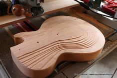 I've been playing a little catchup with the build blog.  Some of these steps happen pretty quickly, but have a bunch of interesting mini-steps to get them done.  The top carve on the guitar is one of those.  Lots of curves, transitions, important angles, heights, etc., all with the goal of subtle elegance. For me, the carved deck is probably the …