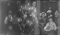 Vintage Christmas Photograph ~ Family Gathered Around a Candle Lit Christmas Tree. Mansfield, OH * 1911