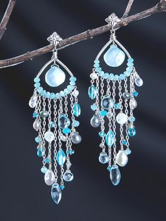 Named after Salacia, the Goddess of salt water who presided over the depths of the sea. Peruvian Chalcedony, Blue Topaz, Apatite, Moonstone, Blue Quartz, Aquamarine, and Pearls are all used in this design by Harmony Scott Jewelry