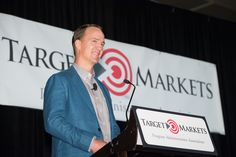 If retired NFL quarterback Peyton Manning felt out of place in a room filled with insurance professionals – miles away from where he was last year on his w