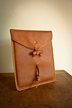 IPad case with leather thong fastener