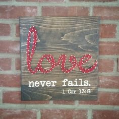 "Love never fails string art is approx. 12"" x 13"" Made from reclaimed wood, nails, chalk paint and embroidery thread. #beerart"